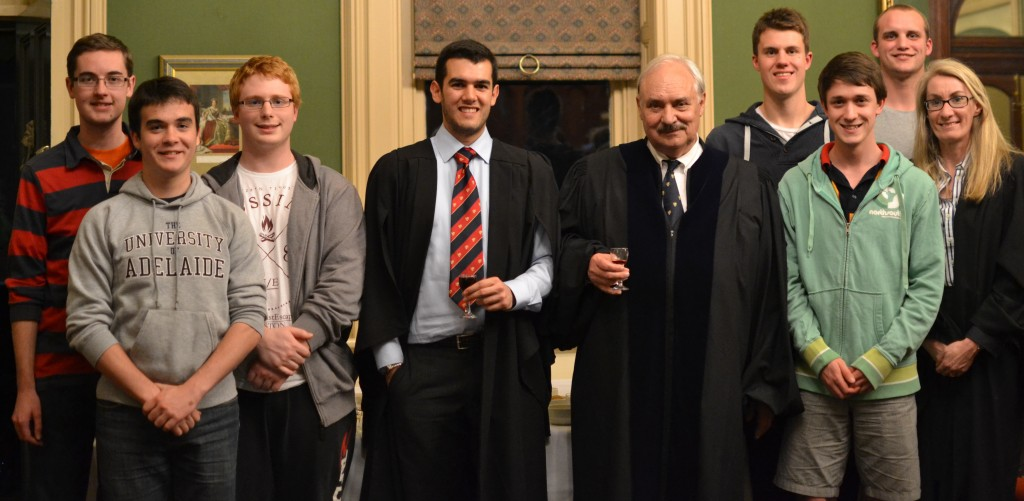Dr Mudge pictured with past students at a Port'n'Talk he gave in 2013.